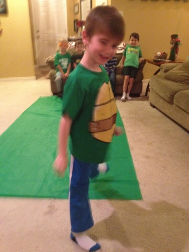 """We laid the green cloth on the ground to be the toxic slime. They had to roll through it and then do their best """"ninja"""" move as they were transformed into a Ninja Turtle"""