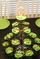 EASIEST cupcakes EVER...candy eyes, green icing, black gel icing and fruit roll up for the masks