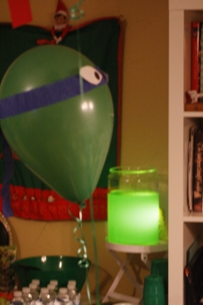 Balloons with crepe paper and cut out ninja turtle eyes