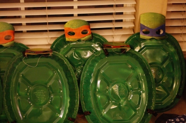 Turtle Shells made from foil roasting pans, green spray paint and some ribbon! Masks were purchased from Target.